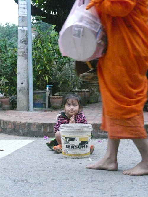 Small girl waiting for donations